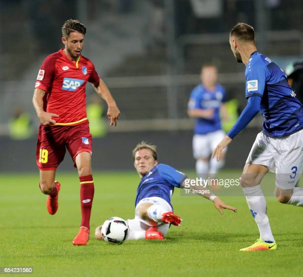 Mark Uth of Hoffenheim Florian Jungwirth of Darmstadt Alexander Milosevic of Darmstadt battle for the ball during the Bundesliga match between SV...