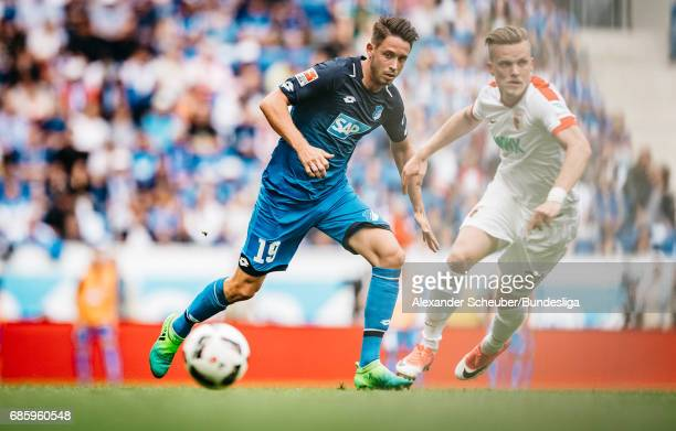 Mark Uth of Hoffenheim in action against Philipp Max of Augsburg during the Bundesliga match between TSG 1899 Hoffenheim and FC Augsburg at Wirsol...
