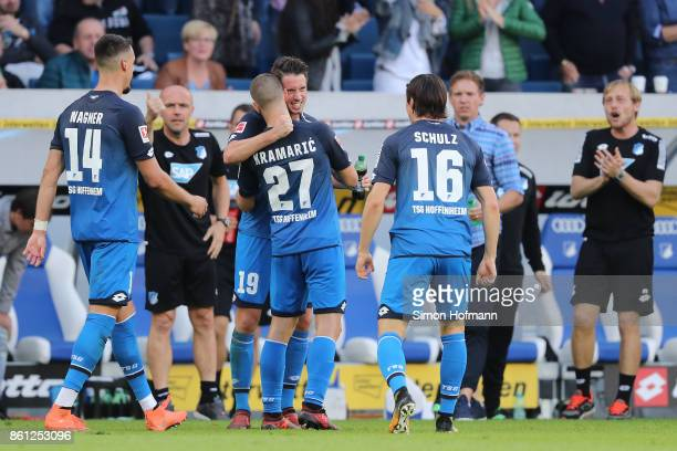 Mark Uth of Hoffenheim is celebrates by his team after he scored a goal to make it 21 during the Bundesliga match between TSG 1899 Hoffenheim and FC...