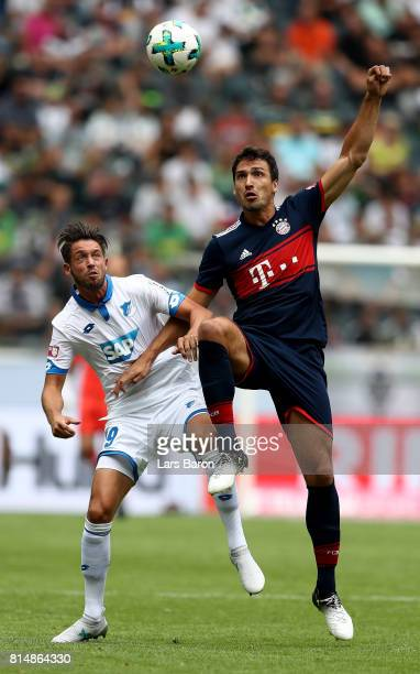 Mark Uth of Hoffenheim is challenged by Mats Hummels of Muenchen during the Telekom Cup 2017 match between Bayern Muenchen and 1899 Hoffenheim at on...