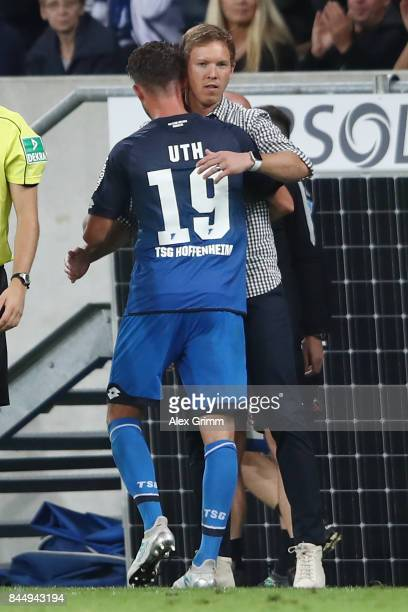 Mark Uth of Hoffenheim is embraced by coach Julian Nagelsmann of Hoffenheim as he is being substituted during the Bundesliga match between TSG 1899...