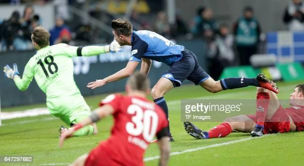 Mark Uth of Hoffenheim scores a goal during the Bundesliga match between TSG 1899 Hoffenheim and 1 FC Koeln at Wirsol RheinNeckarArena on December 3...