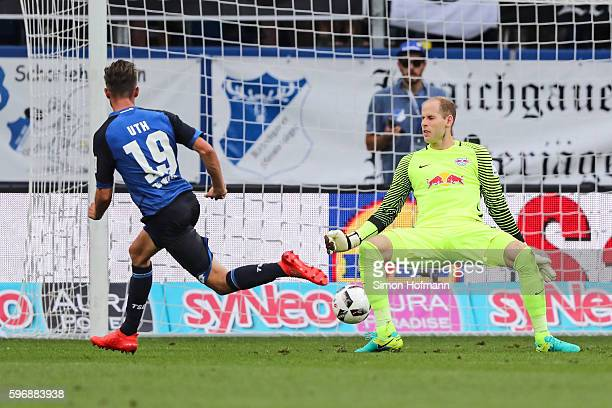 Mark Uth of Hoffenheim scores his team's second goal against Peter Gulacsi of Leipzig during the Bundesliga match between TSG 1899 Hoffenheim and RB...