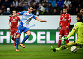 Mark Uth of Hoffenheim scores his team's second goal past goalkeeper Loris Karius of Mainz during the Bundesliga match between 1899 Hoffenheim and 1...