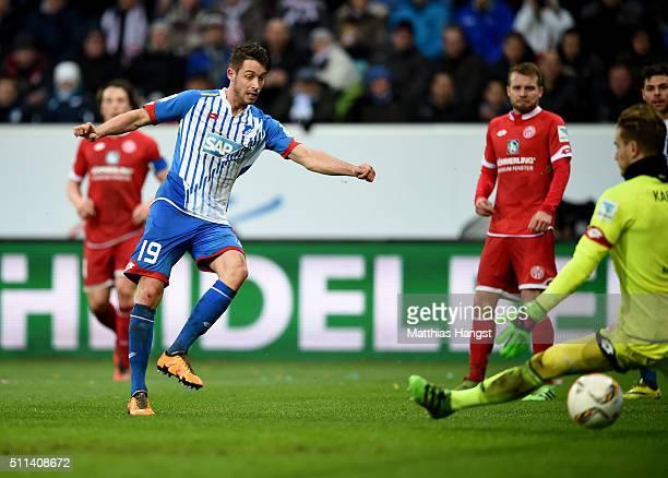 Mark Uth of Hoffenheim scores his team's second goal past goalkeeper Loris Karius of Mainz during the Bundesliga match between 1899 Hoffenheim and 1...