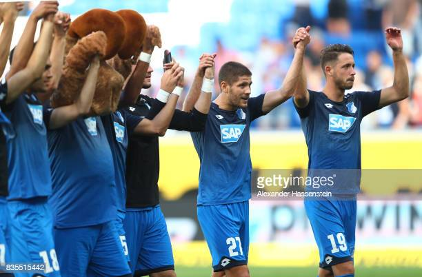 Mark Uth of TSG 1899 Hoffenheim and Andrej Kramaric of TSG 1899 Hoffenheim celebrate with fans and team members after the Bundesliga match between...