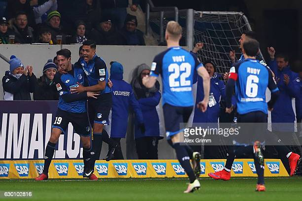 Mark Uth of TSG 1899 Hoffenheim celebrates scoring his teams first goal of the game with team mates during the Bundesliga match between TSG 1899...