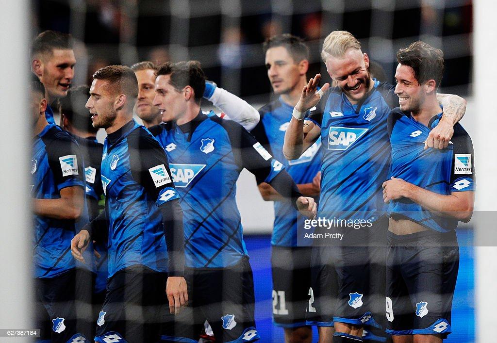 Mark Uth of TSG 1899 Hoffenheim is congratulated by Kevin Vogt after scoring the fourth goal during the Bundesliga match between TSG 1899 Hoffenheim and 1. FC Koeln at Wirsol Rhein-Neckar-Arena on December 3, 2016 in Sinsheim, Germany.