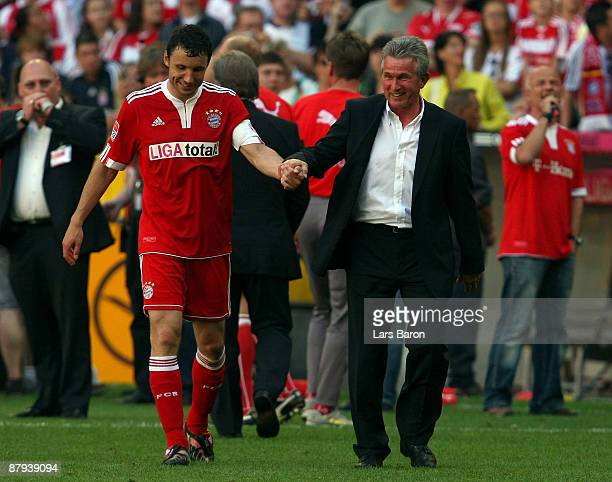 Mark van Bommel and headcoach Jupp Heynckes of Muenchen celebrate after winning the Bundesliga match between FC Bayern Muenchen and VfB Stuttgart at...