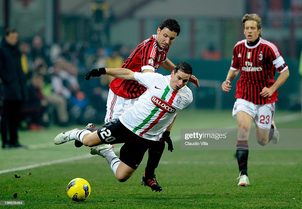 Mark Van Bommel of AC Milan and Simone Padoin #20 of Juventus FC clash during the Tim Cup match between AC Milan and Juventus FC at Giuseppe Meazza Stadium on February 8, 2012 in Milan, Italy.