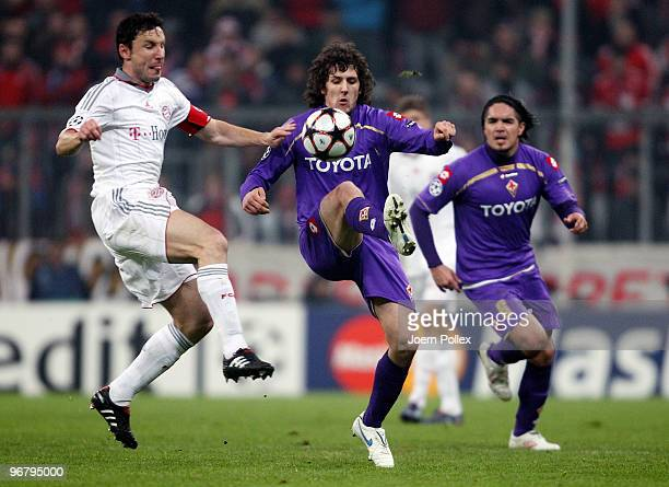 Mark van Bommel of Bayern Stevan Jovetic and Juan Vargas of Florence jump for a header during the UEFA Champions League round of sixteen first leg...