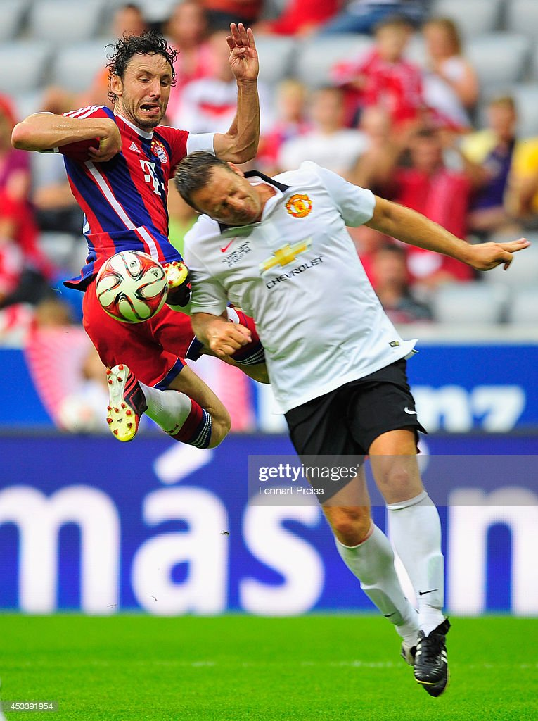 Mark van Bommel (L) of FCB AllStars challenges <a gi-track='captionPersonalityLinkClicked' href=/galleries/search?phrase=Denis+Irwin&family=editorial&specificpeople=221637 ng-click='$event.stopPropagation()'>Denis Irwin</a> of ManUtd Legends during the friendly match between FC Bayern Muenchen AllStars and Manchester United Legends at Allianz Arena on August 9, 2014 in Munich, Germany.