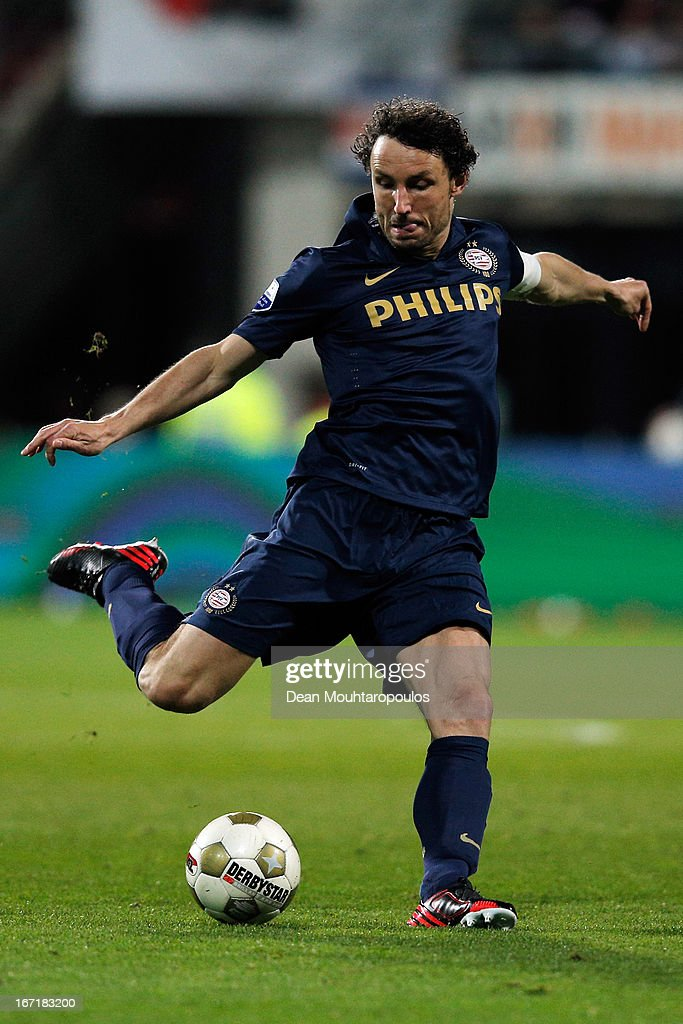 <a gi-track='captionPersonalityLinkClicked' href=/galleries/search?phrase=Mark+Van+Bommel&family=editorial&specificpeople=221166 ng-click='$event.stopPropagation()'>Mark Van Bommel</a> of PSV shoots on goal during the Eredivisie match between AZ Alkmaar and PSV Eindhoven at the AFAS Stadium on April 20, 2013 in Alkmaar, Netherlands.