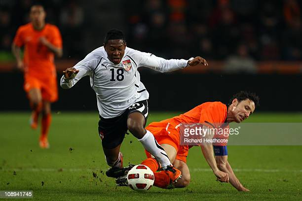Mark van Bommel of The Netherlandstackles David Alaba of Austria during the International Friendly match between The Netherlands and Austria at the...