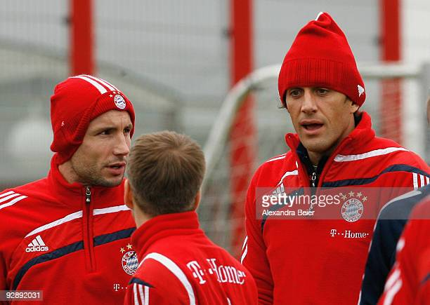 Mark van Bommel Philipp Lahm and Luca Toni chat during the Bayern Muenchen training session at Bayern's training ground 'Saebener Strasse' on...