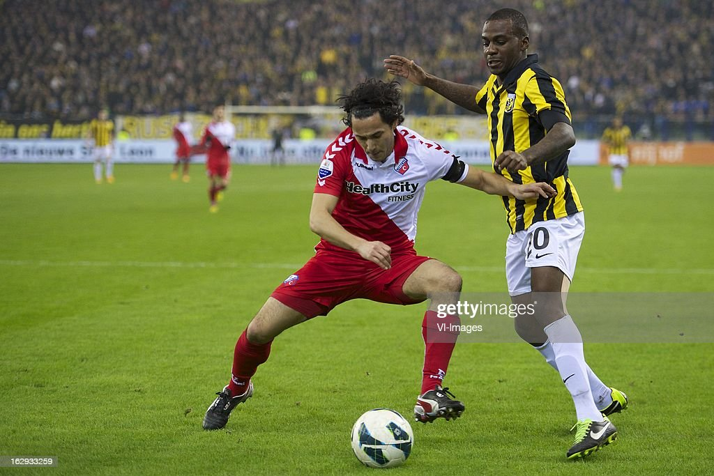 Mark van der Maarel of FC Utrecht, Gael Kakuta of Vitesse during the Dutch Eredivisie match between Vitesse Arnhem and FC Utrecht at the Gelredome on march 01, 2013 in Arnhem, The Netherlands