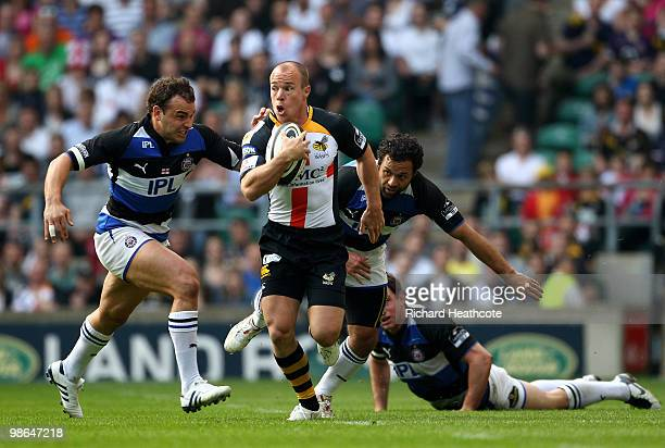 Mark van Gisbergen of Wasps tries to get away from Olly Barkley and Joe Maddock of Bath during the Guinness Premiership St George's Day Game between...