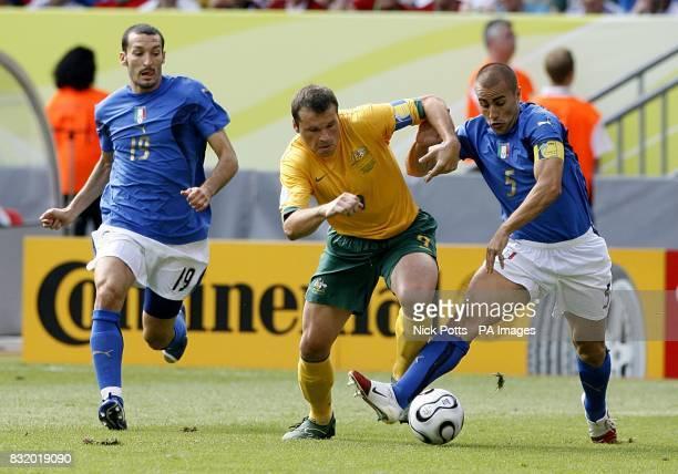 Mark Viduka Australia and Fabio Cannavaro Italy battle for the ball