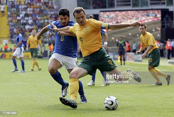 Mark Viduka of Australia crosses the ball as Gennaro Gattuso of Italy closes in during the FIFA World Cup Germany 2006 Round of 16 match between...