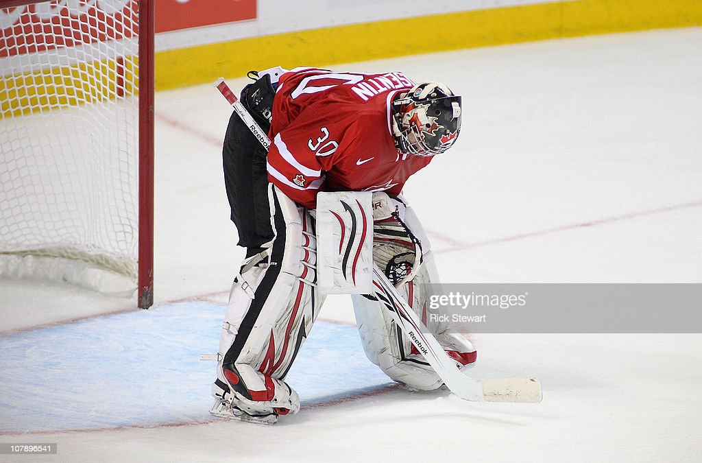 Mark Visentin #30 of Canada standds in front of his net after allowing Russia's fifth goal of the third period during the 2011 IIHF World U20 Championship Gold medal game between Canada and Russia on January 5, 2011 in Buffalo, New York. ussia won the gold medal with a 5-3 win.