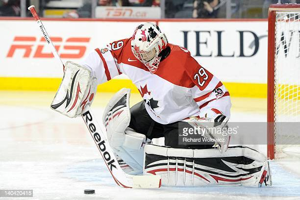 Mark Visentin of Team Canada stops the puck during the 2012 World Junior Hockey Championship Bronze Medal game against Team Finland at the Scotiabank...