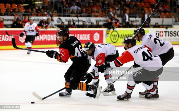 Mark Voakes of Wolfsburg and Vladimir Mihalik of Bystrica battle for the puck during the Champions Hockey League match between Grizzlys Wolfsburg and...