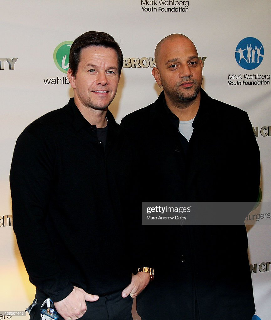 <a gi-track='captionPersonalityLinkClicked' href=/galleries/search?phrase=Mark+Wahlberg&family=editorial&specificpeople=202265 ng-click='$event.stopPropagation()'>Mark Wahlberg</a> and Director Allen Hughes attend the screening of 'Broken City' hosted by <a gi-track='captionPersonalityLinkClicked' href=/galleries/search?phrase=Mark+Wahlberg&family=editorial&specificpeople=202265 ng-click='$event.stopPropagation()'>Mark Wahlberg</a> at Patriot Cinemas on January 15, 2013 in Hingham, Massachusetts.