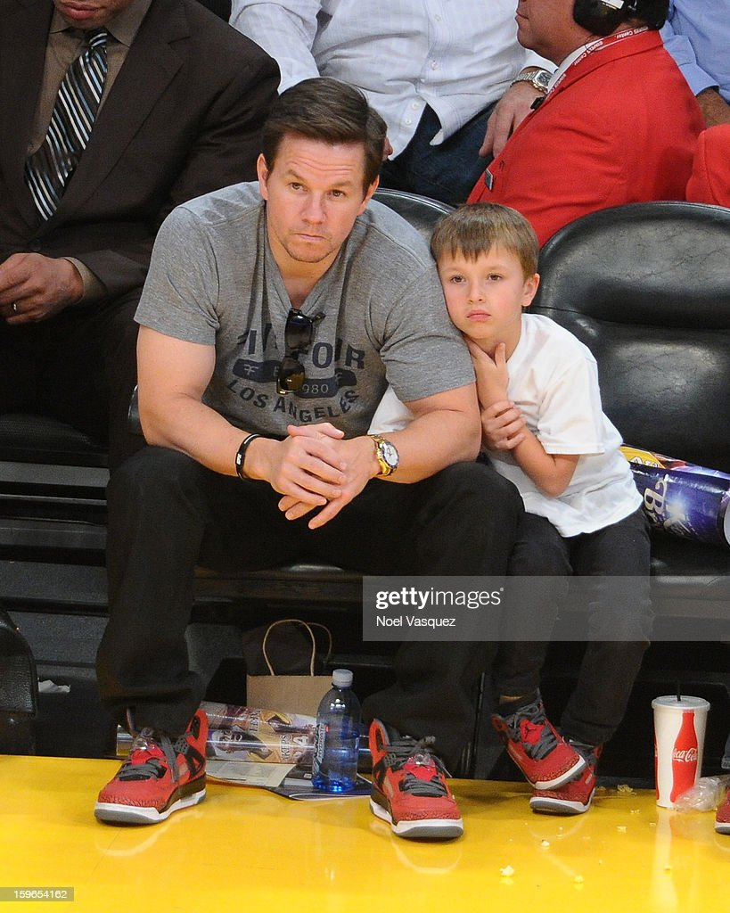 Mark Wahlberg (L) and his son Michael Wahlberg attend a basketball game between the Miami Heat and the Los Angeles Lakers at Staples Center on January 17, 2013 in Los Angeles, California.
