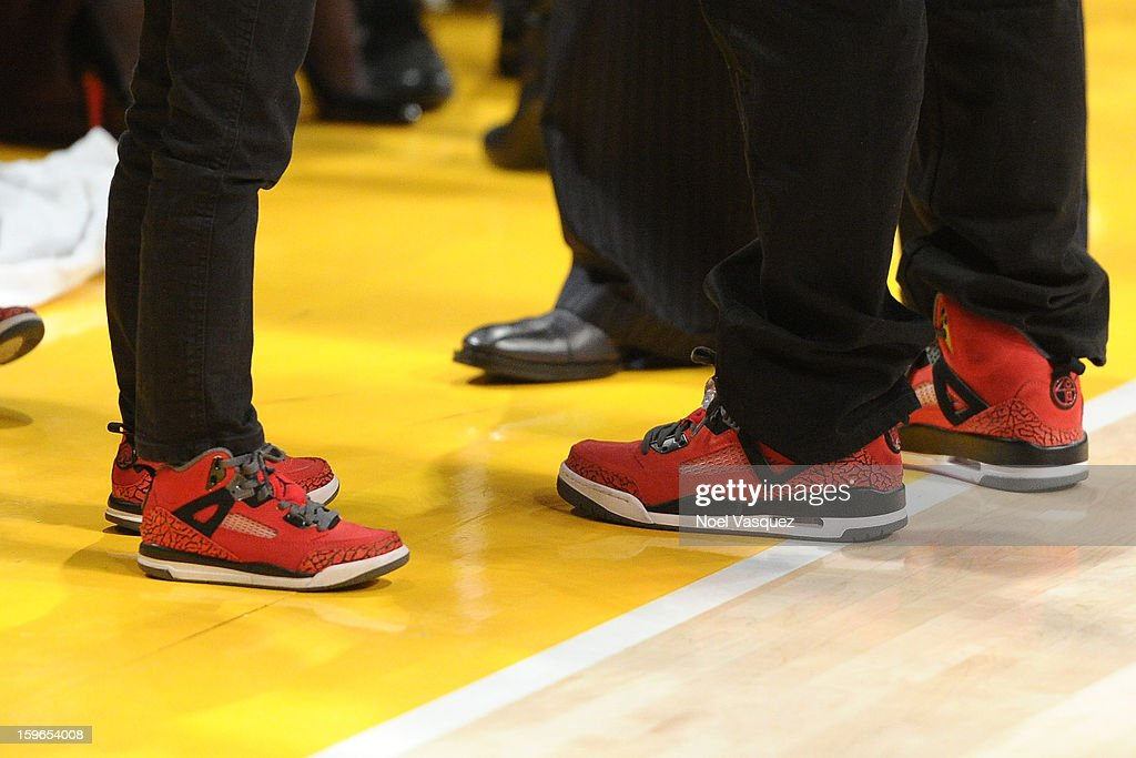 Mark Wahlberg and his son wear matching shoes at a basketball game between the Miami Heat and the Los Angeles Lakers at Staples Center on January 17, 2013 in Los Angeles, California.