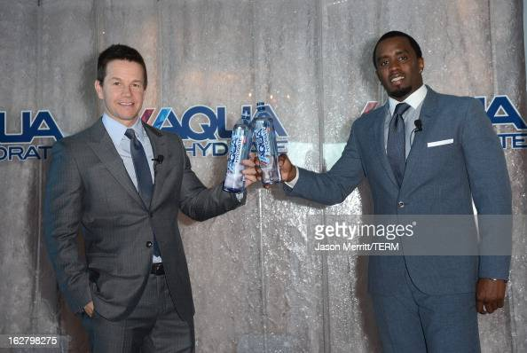 Mark Wahlberg and Sean Combs pose onstage while hosting a press conference to announce their newest venture Water Brand AQUAhydrate on February 27...
