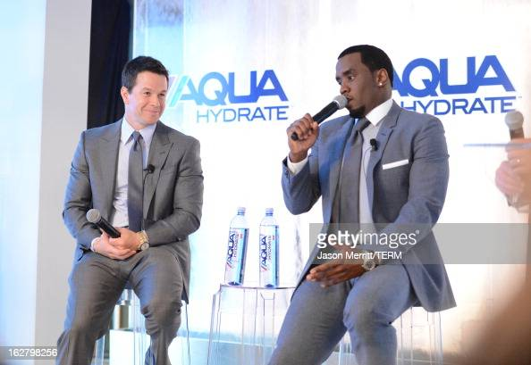 Mark Wahlberg and Sean Combs speak onstage during a press conference to announce their newest venture Water Brand AQUAhydrate on February 27 2013 in...