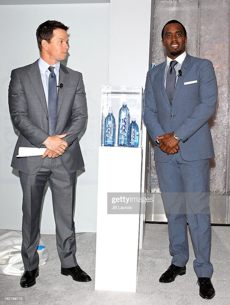 Mark Wahlberg and Sean Combs speak onstage while hosting a press conference to announce their newest venture, Water Brand AQUAhydrate on February 27, 2013 in Los Angeles, California.