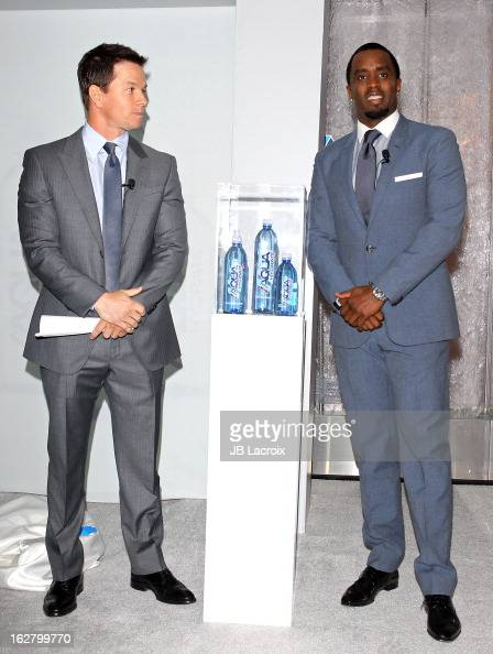 Mark Wahlberg and Sean Combs speak onstage while hosting a press conference to announce their newest venture Water Brand AQUAhydrate on February 27...