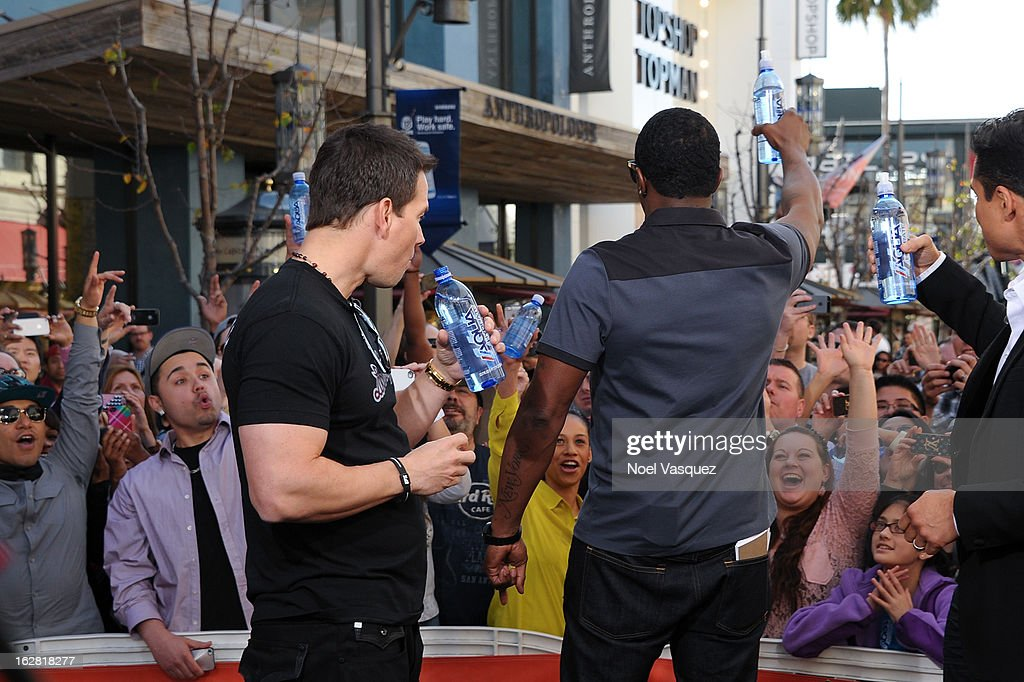 Mark Wahlberg (L) and Sean Combs visit Extra at The Grove on February 27, 2013 in Los Angeles, California.