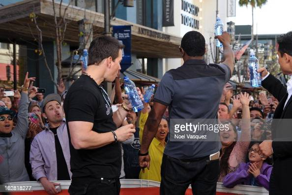 Mark Wahlberg and Sean Combs visit Extra at The Grove on February 27 2013 in Los Angeles California