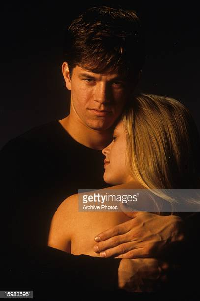 Mark Wahlberg holding Reese Witherspoon in publicity portrait for the film 'Fear' 1996