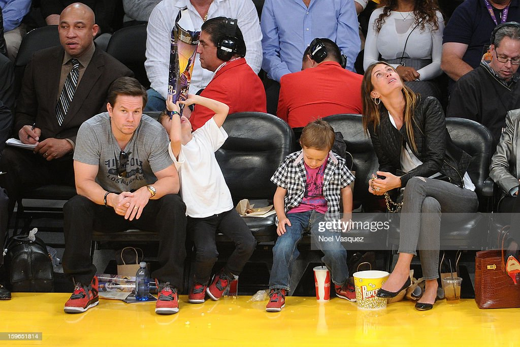 Mark Wahlberg, Michael Wahlberg, Brendan Wahlberg and Rhea Durham attend a basketball game between the Miami Heat and the Los Angeles Lakers at Staples Center on January 17, 2013 in Los Angeles, California.