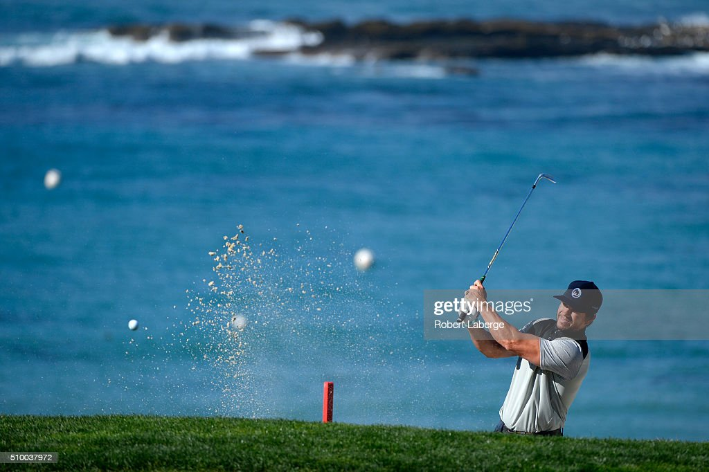 Mark Wahlberg plays a shot from the bunker near the fifth green during round three of the AT&T Pebble Beach National Pro-Am at the Pebble Beach Golf Links on February 13, 2016 in Pebble Beach, California.