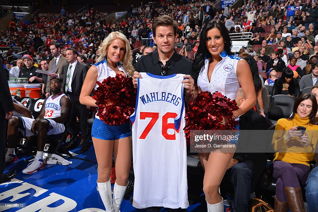 <a gi-track='captionPersonalityLinkClicked' href=/galleries/search?phrase=Mark+Wahlberg&family=editorial&specificpeople=202265 ng-click='$event.stopPropagation()'>Mark Wahlberg</a> presented with his 76ers jersey during a time out by two of the Sixers Dream Team dancers at the Wells Fargo Center on January 8, 2013 in Philadelphia, Pennsylvania.