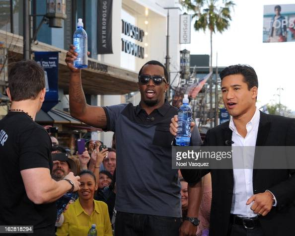 Mark Wahlberg Sean Combs and Mario Lopez visit Extra at The Grove on February 27 2013 in Los Angeles California