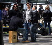 Mark Wahlberg second from right in plaid working on the set of the movie Ted directed by Seth McFarlane in the Boston Public Garden