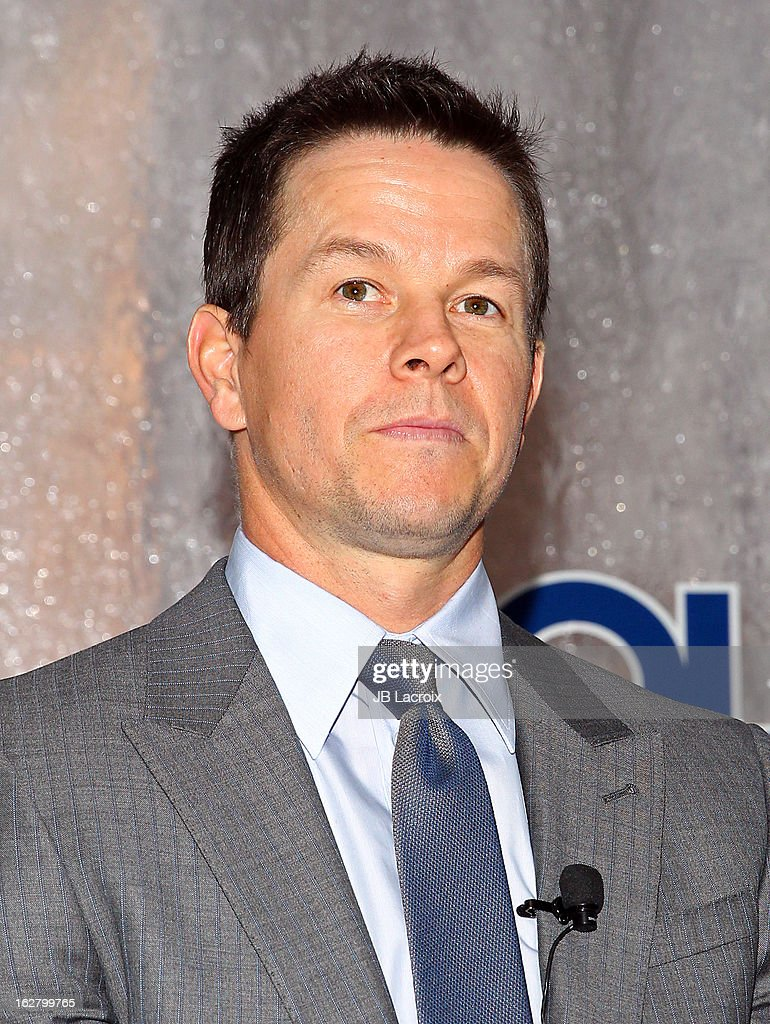 Mark Wahlberg speaks onstage while hosting a press conference to announce their newest venture, Water Brand AQUAhydrate on February 27, 2013 in Los Angeles, California.