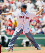 Mark Wahlberg throws out the ceremonial first pitch before the Boston Red Sox versus the Seattle Mariners game on July 5 2009 at Fenway Park in...
