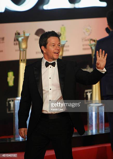 Mark Wahlberg waves to his fans at the Shanghai premiere of 'Transformers' on June 22 2014 in Shanghai China