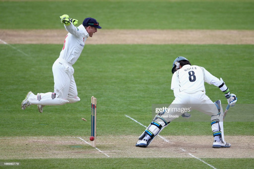 Mark Wallace (L) of Glamorgan celebrates the wicket of Moeen Ali (R) of Worcestershire as he plays on off the bowling of Will Bragg during day three of the LV County Championship Division Two match between Glamorgan and Worcestershire at the SWALEC Stadium on April 19, 2013 in Cardiff, Wales.