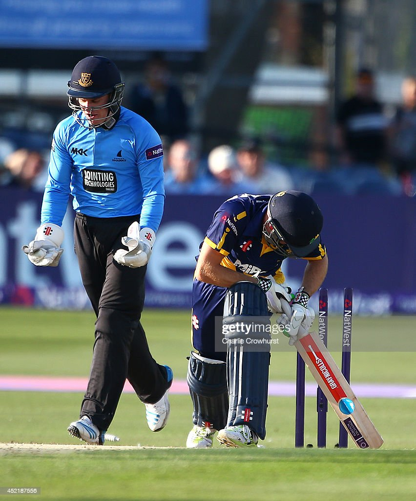Mark Wallace of Glamorgan is bowled out by Will Beer of Sussex while Ben Brown celebrates during the Natwest T20 Blast match between Sussex Sharks and Glamorgan at The BrightonAndHoveJobs.com County Ground on July 15, 2014 in Hove, England.