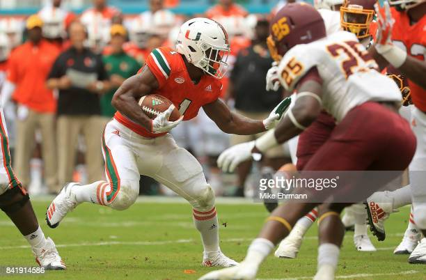 Mark Walton of the Miami Hurricanes rushes during a game against the Bethune Cookman Wildcats at Hard Rock Stadium on September 2 2017 in Miami...