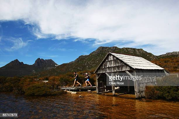 Mark Webber and Emma Weitnauer run past the boat shed on their way to Cradle Mountain during day one of the Mark Webber Pure Tasmania Challenge 2008...