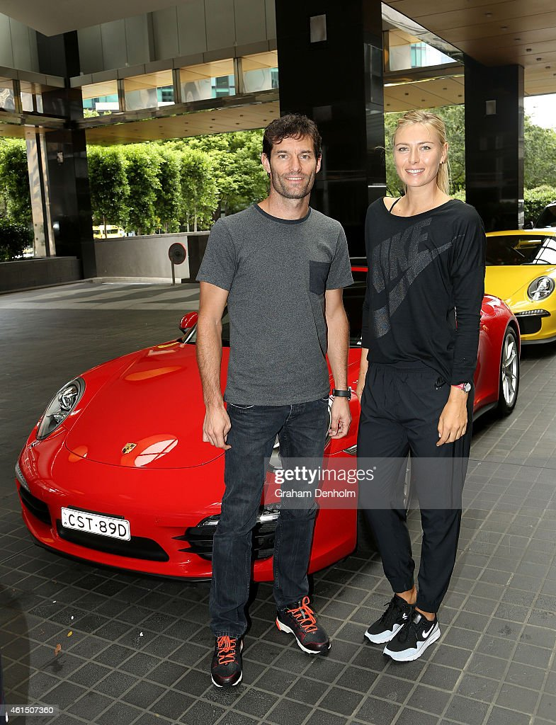 Mark Webber and Maria Sharapova pose prior to driving to practice at Rod Laver Arena in preparation for the 2015 Australian Open during a Porsche photo call on January 14, 2015 in Melbourne, Australia.