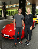 Mark Webber and Maria Sharapova pose prior to driving to practice at Rod Laver Arena in preparation for the 2015 Australian Open during a Porsche...